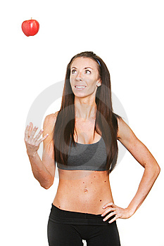 Fitness Woman Tossing Up A Red Apple Stock Photo - Image: 8508170