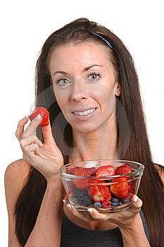 Fitness Woman Eating Fresh Fruit Royalty Free Stock Image - Image: 8508286