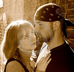 Young Couple Against A Brick Wall Stock Image - Image: 8509301