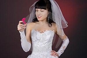Beautiful Bride Looking At Wedding Ring Royalty Free Stock Image - Image: 8511466