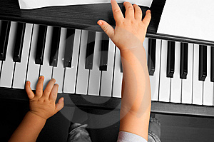 Baby Going To Play The Piano Royalty Free Stock Photos - Image: 8517838