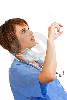 Caucasian Female Doctor Checking Syringe Stock Photos - Image: 8520393