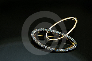 A Breast-pin With Two Rings Across Royalty Free Stock Photography - Image: 8521057