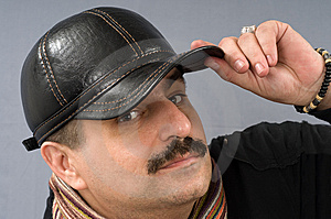 The Man In A Black Peak-cap. Royalty Free Stock Photography - Image: 8523947