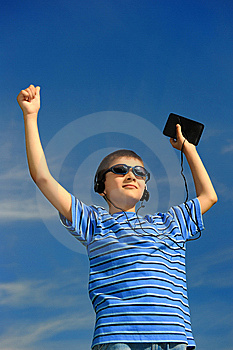 Boy Listens To Music Royalty Free Stock Photography - Image: 8525867