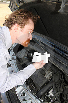 Checking Engine Oil Dipstick Royalty Free Stock Photo - Image: 8529305
