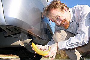 Man Putting Banana Into Car Exhaust Stock Photos - Image: 8529463