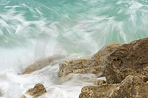 Green Waves Hitting Rocky Cliff Stock Photos - Image: 8535083