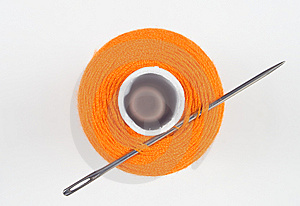 Orange Sewing Spool With Needle Stock Photography - Image: 8535782