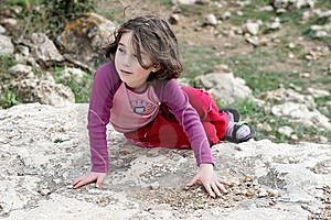 Little Girl On The Rock Royalty Free Stock Photos - Image: 8537788