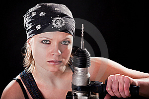 Severe Young Woman With A Drill Stock Photo - Image: 8544810