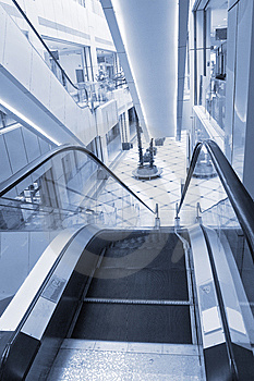 Shopper And Escalator Stock Photo - Image: 8544930