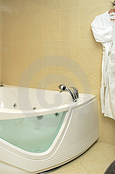 Fragment Of Bathtub And Bathrobe Royalty Free Stock Photos - Image: 8546568