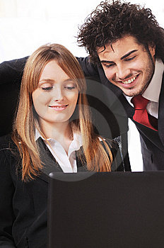 Worker Couple Uses Laptop Stock Photo - Image: 8548910