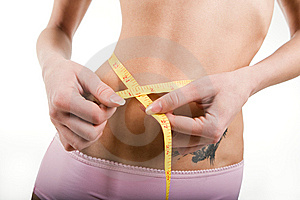 Slim Girl Measuring Torso With Tape Royalty Free Stock Images - Image: 8557619