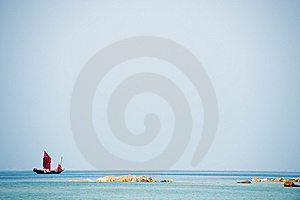 Traditional Chinese Junk Boat On The Horizon Royalty Free Stock Photo - Image: 8558575