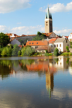 Tower And Houses With Lake Reflection Royalty Free Stock Image - Image: 8561436