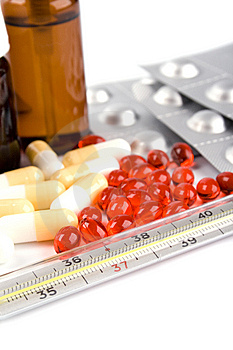 Thermometer And Pills Stock Photography - Image: 8561842