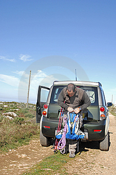Hiker Preparing The Knapsack Royalty Free Stock Image - Image: 8562536