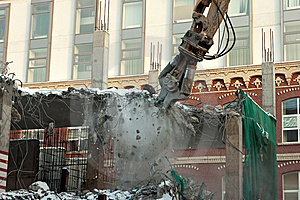 Heavy Dredger Demolishes Building Royalty Free Stock Images - Image: 8563999