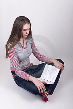 Girl Sitting On The Floor And Reading Stock Image - Image: 8567091