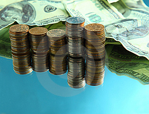 Cash Dollars And Pile Of Coins Stock Images - Image: 8568494