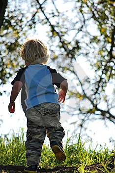 Small Boy Running Up A Hill Stock Photography - Image: 8575302