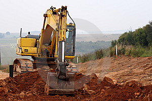Excavator Digging Up Some Ground And Rocks #3 Stock Photography - Image: 8578362