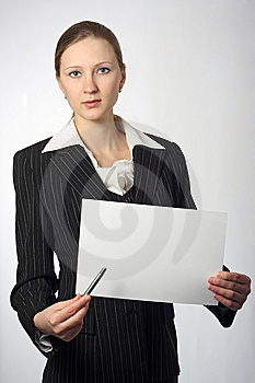 Young Beautiful Businesswoman With Sheet And Pen Royalty Free Stock Photography - Image: 8578377