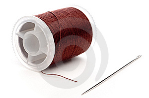 Closeup Of A Spool Of Brown Thread And A Needle Royalty Free Stock Photo - Image: 8581305