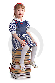Schoolgirl Sitting On The Heap Of Books Royalty Free Stock Photos - Image: 8585268