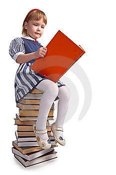 Schoolgirl Sitting On The Heap Of Books Royalty Free Stock Images - Image: 8585279