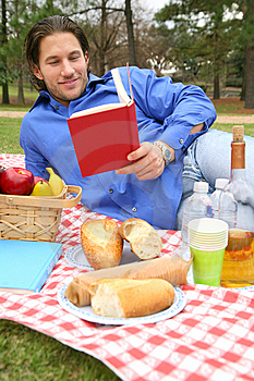 Young Caucasian Male Reading Book Outdoor Stock Photography - Image: 8588872