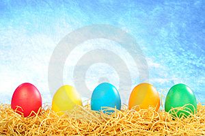 Five Painted Eggs On A Straw On A Sky Background Royalty Free Stock Image - Image: 8589386