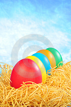 Five Painted Eggs In Straw On A Sky Background Royalty Free Stock Photography - Image: 8589417