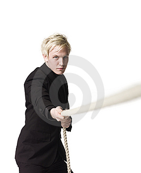 Boy Pulling A Rope Royalty Free Stock Photography - Image: 8590607