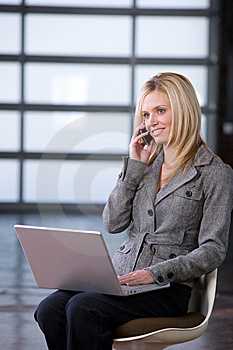 Business Woman On A Cell Phone Royalty Free Stock Photography - Image: 8592227
