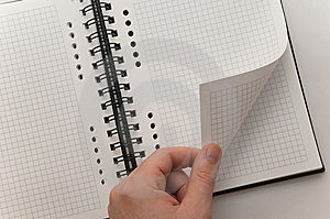 Hand Turning Page Of Blank Spiral Notebook Royalty Free Stock Image - Image: 8598136