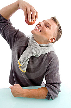 Smiling Young Man Going To Eat Apple Royalty Free Stock Images - Image: 8601919
