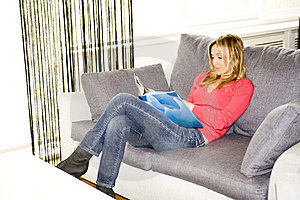 Reading On Her Sofa Royalty Free Stock Photos - Image: 8602458