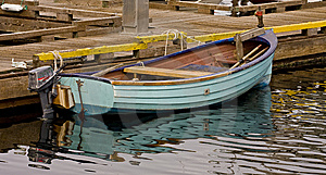 Small Blue Boat At A Pier Royalty Free Stock Image - Image: 8602676