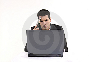 Businessman With Lap Top Computer And Phone. Stock Photos - Image: 8604533