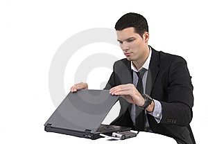 Businessman With Lap Top Computer And Phone Royalty Free Stock Image - Image: 8604736