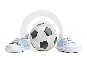 Football / Soccer Ball With Baby Shoes Royalty Free Stock Photo - Image: 8605655