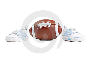 Football With Baby Shoes Royalty Free Stock Photos - Image: 8605668