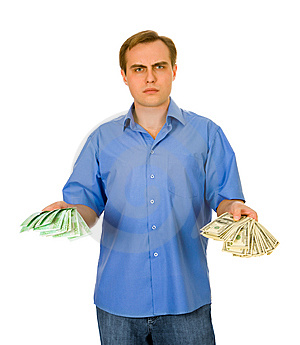 Guy With Dollars And Euros. Isolated On White. Stock Image - Image: 8607111