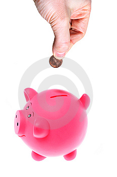 Hand Inserting Coin Into Piggy Bank Royalty Free Stock Images - Image: 8609379