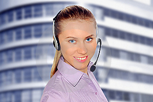 Woman Wearing Headset In Office;could Be Reception Royalty Free Stock Photography - Image: 8612997