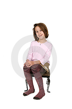 Young Girl In Funky Outfit Sitting On Stool Stock Images - Image: 8618094