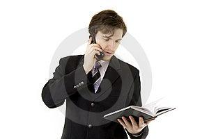 Hombre De Negocios Con El Teléfono Y Diario Fotografía de archivo - Imagen: 8618162